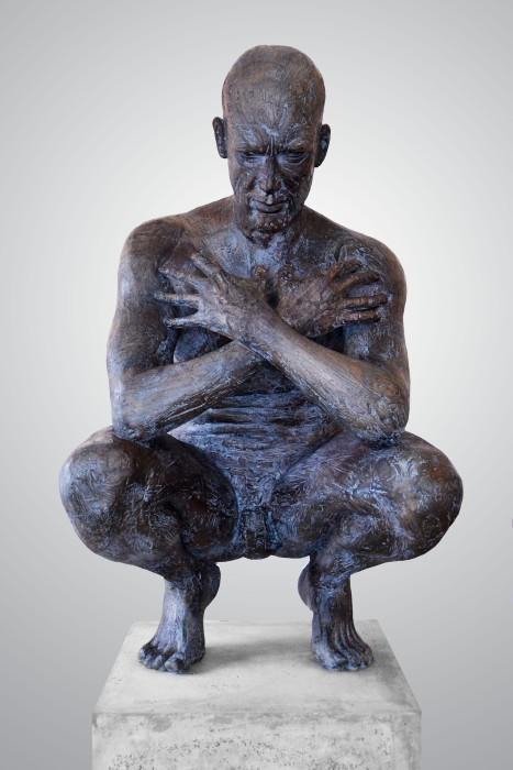 Anton Smit's sculpture titled 'Crouching Man'